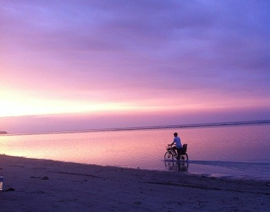 Cycling along the beach of Gili Air in Lombok, Indonesia