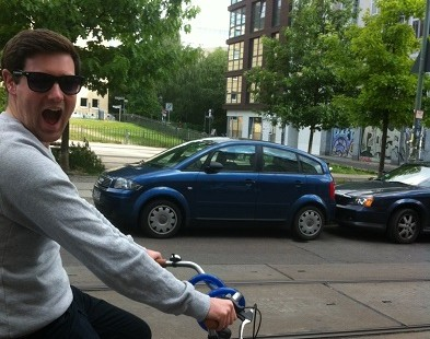 Josh from The Carter Company's team tours Berlin on a bike