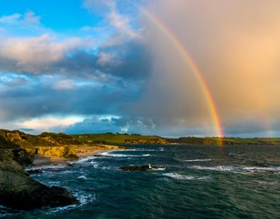 Rainbow in summer over the sea in Cornwall