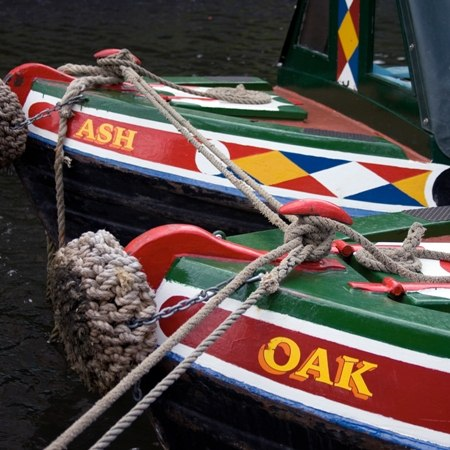 Traditional canal boats linked together