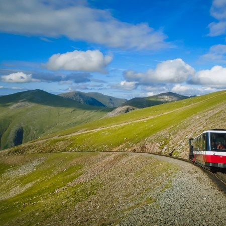 Cycling holiday in Wales with a train ride up Snowdonia, stays in 4 luxury boutique hotels and E bikes to steam over the hills