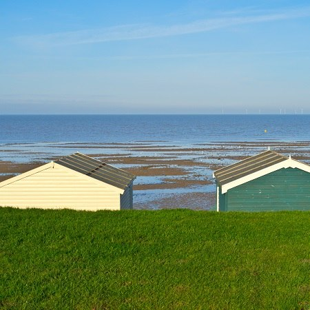 Amble past beach huts and along sandy shores on our Kent walking holiday