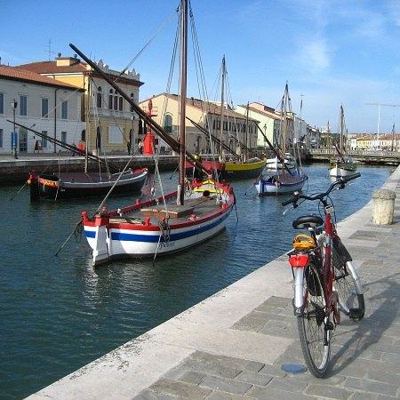 Colourful canal scene - discover this and more on our Really Rather Special cycling holiday in Italy