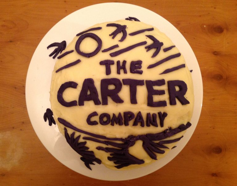 The Carter Company logo on a home-made cake