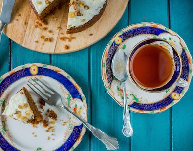 Tea and cake served on a table - our favourite thing about cycling and walking holiday pit stops