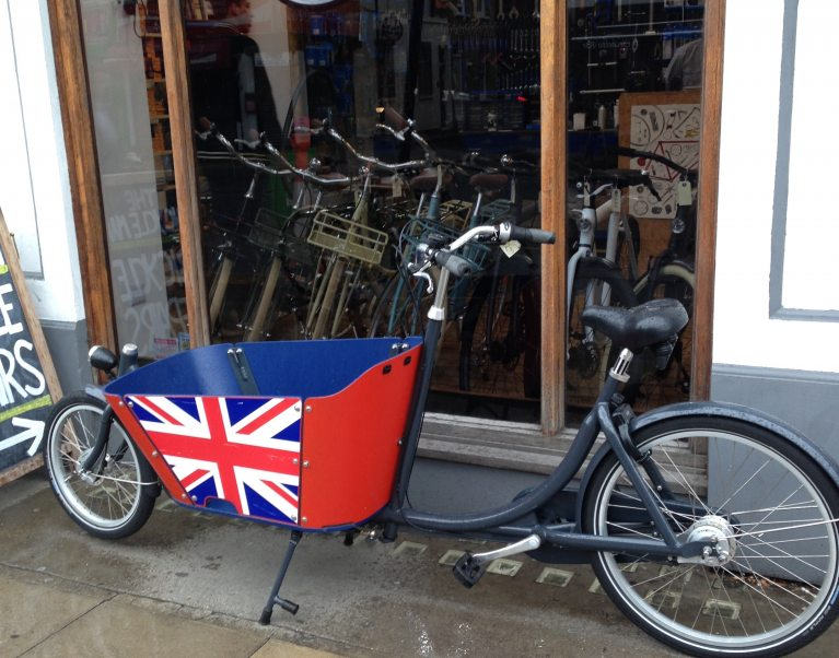 A cargo bicycle painted with the British flag outside a shop in London
