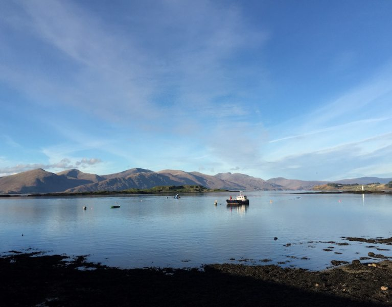 Image looking out to the loch from Port Appin in Scotland in the late afternoon. Visit Port Appin on our Scottish self-guided luxury cycling holidays
