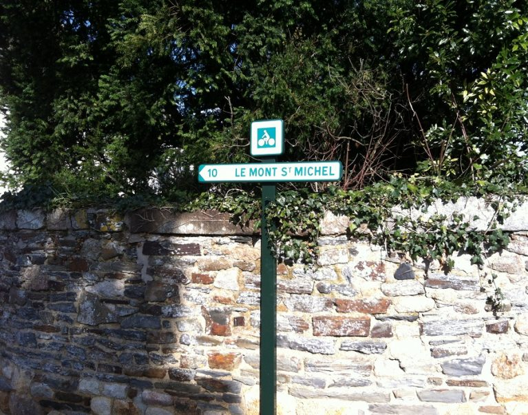 Signpost showing the cycle route to Mont St Michel in Brittany, France - photographed on a Carter Company cycling tour